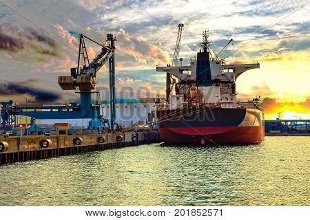 Ship under loading in Port of Gdansk Poland.
