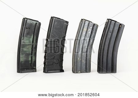 Empty cartridge for gun. 20 caliber handgun magazine on white loaded with hollow point cartridges. blue colored Gun magazine.