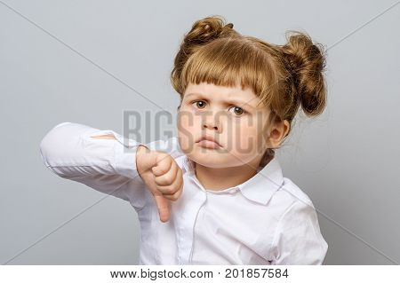 Unhappy Little Girl Showing Thumb Down