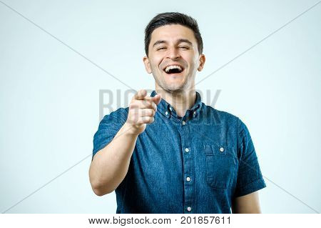 Portrait Happy Young Man, Laughing, Pointing With Finger At Someone