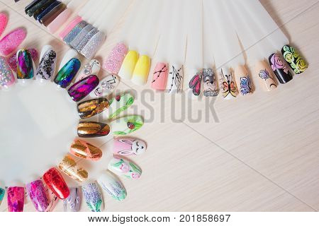Nail samples big collection of fingernails painted in various color with different pattern selective focus