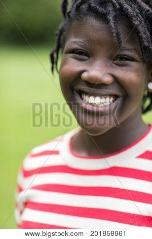 Head And Shoulders Outdoor Portrait Of Smiling Teenage Girl