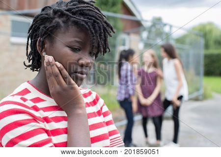 Sad Teenage Girl Feeling Left Out By Friends