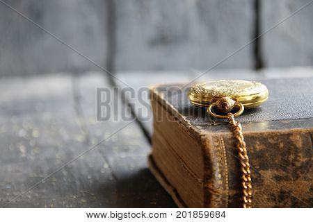 vintage background old gold pocket watch retro book