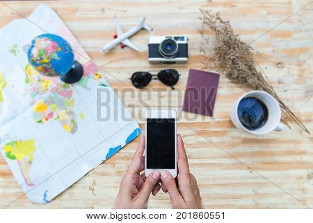 Travel planning concept on mapFlat lay of accessories on wooden desk background of photographer Voyage concept.