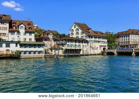 Zurich, Switzerland - 18 June, 2017: the Limmat river and city's old town buildings along it. Zurich is the largest city in Switzerland and the capital of the Swiss canton of Zurich.