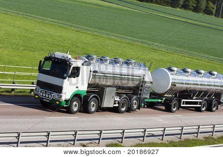 oil-tanker, truck on highway against green countryside