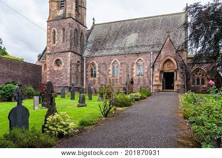 Saint Andrew's Church landmark in Fort William Scotland United Kingdom. Cloudy rainy day and calm atmosphere.