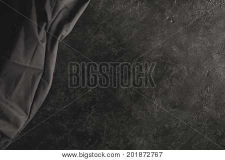 close up view of black tablecloth isolated on black tabletop