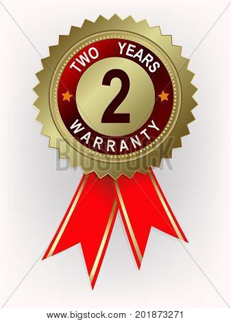 Round emblem of golden color with red ribbons and text two year warranty