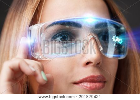 Young Businesswoman Working In Virtual Glasses, Select The Icon Compliance On The Virtual Display