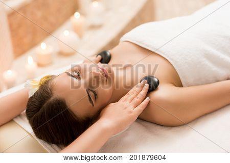 Woman Having Stone Massage