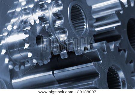 gear-machinery against titanium, in a deep-blue metallic cast
