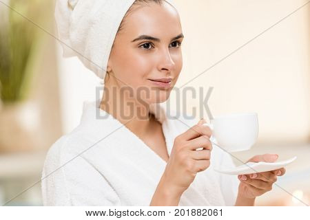 Woman Drinking Tea After Spa