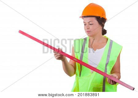 Attractive Woman Worker in Safety Jacket and Yellow Helmet with Bubble Level Gauge on a white background