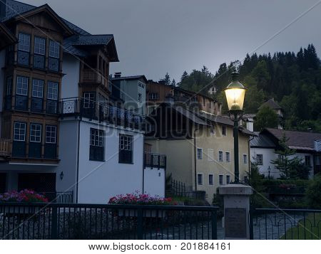 Night town Hallstatt with mountain lake and salt mines. Alpine massif, beautiful canyon in Austria. Salzburg Alpine valley in summer, clear water. Destination for vacation, hiking and relaxation.