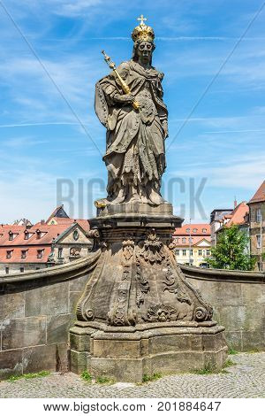 Statue of Saint Cunigunde of Luxembourg as Holy Roman Empress stands over the Regnitz river in Bamberg Bavaria Germany. Built 1750 from Johann Peter Benkert.1750 from Johann Peter Benkert.