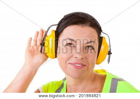 Attractive Woman Worker in Safety Jacket and Protective Ear Headphones on a white background