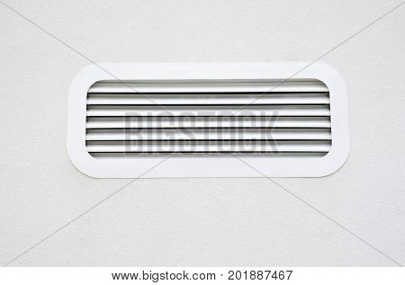 New white air conditioning vent on wall closeup