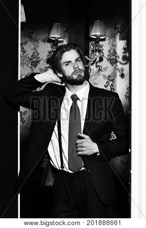 bearded man businessman long beard brutal caucasian hipster with moustache has serious face unshaven guy with stylish hair in suit and red tie wallpaper background