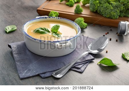 Broccoli cheddar soup in casserole on kitchen table