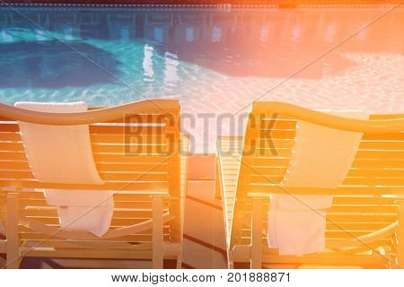 Sunloungers by swimming pool
