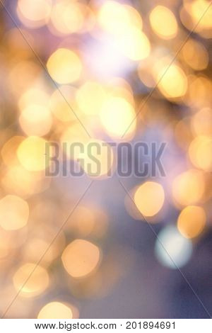 Christmas background with natural bokeh and twinkled defocused lights. Festive blur background