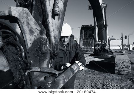 bulldozer, digger and driver in a bluish toning concept