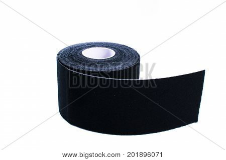 black kinesiology tape. Physiotherapy and therapeutic tape for wrist pain, aches and tension. elastic therapeutic tape. adhesive tape and alternative medicine.