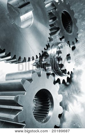 large industrial gears set against titanium and in a blue metallic toning concept