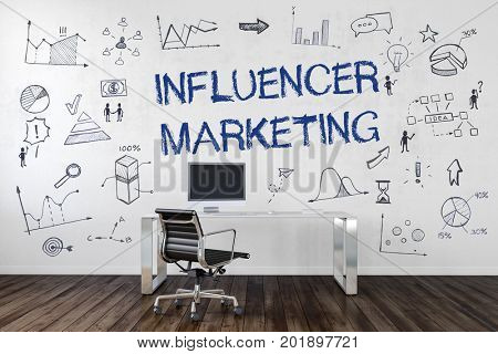 Influencer Marketing text and business icons hand drawn on an office wall with a modern perspex desk, chair and computer below in a conceptual image. 3d Rendering.