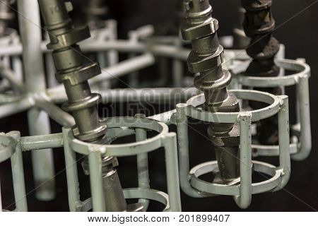 The camshaft casting pats in cleaning process.Automobile part manufacturing.