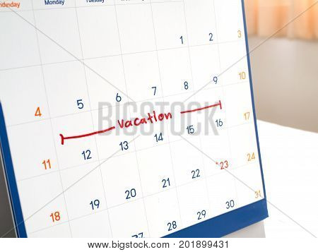 Red vacation write on white calendar marked for remember and target time to long vacation and relax time.