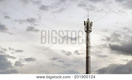 stanchion of Telecommunication mast TV antennas wireless technology on sky and cloud in background.