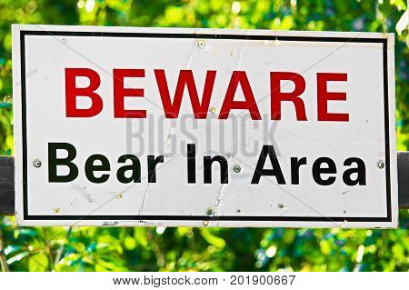 A White Beware Bear In Area Sign