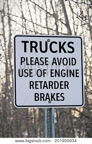 Close Up of Trucks Avoid Retard Brakes Sign.