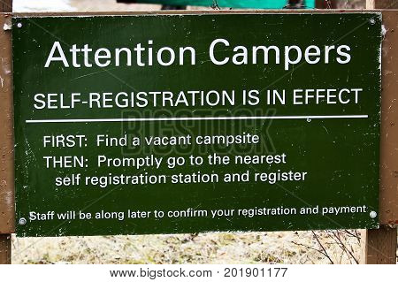 An attention camping self registration instruction sign.