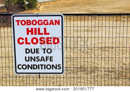 Toboggan Hill Closed Sign Posted In A Public Park Once All The Snow Has Melted