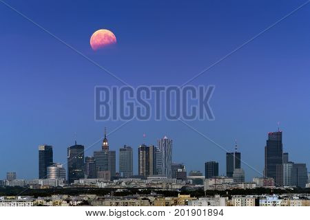 Full moon in partial eclipse over Warsaw city Poland