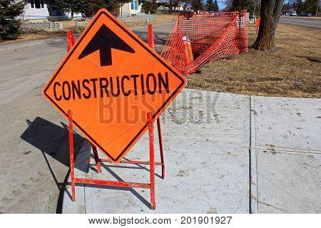 Temporary Construction Ahead Sign On A Sidewalk