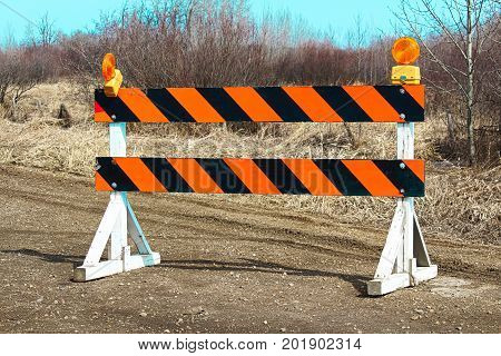 A construction barricade along a country road.