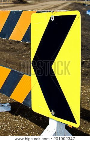 Close-up of a bright yellow detour roadblock.