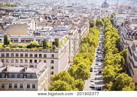 Aerial cityscape view on the avenue near the Triumphal arch during the sunny day in Paris