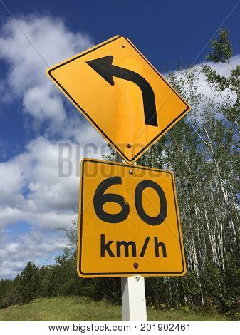 Suggested Sixty Kilometer Per Hour Sign Around Bend
