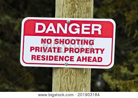 No shooting sign indicating private residence ahead.