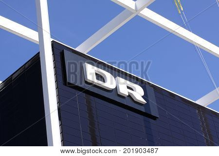 DR - danmarks radio DR logotype on a panel. Danmarks Radio, abbreviated DR is the danish public broadcasting company founded in 1925, Copenhagen, Denmark August 29, 2017