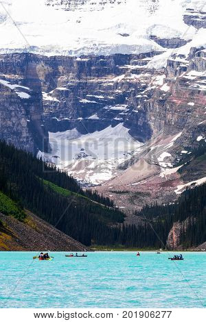 Beautiful close up view of Lake Louise in Banff National Park in the Rocky Mountains Alberta Canada. With canoes in the foreground.