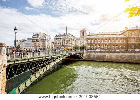 Landscape view on the riverside with Notre Dame basilica in Paris