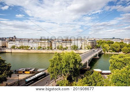 Aerial cityscape view on the riverside and bridge in Paris