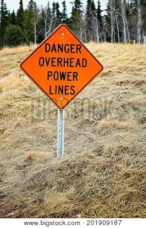 Danger Overhead Powerline Sign In The Country